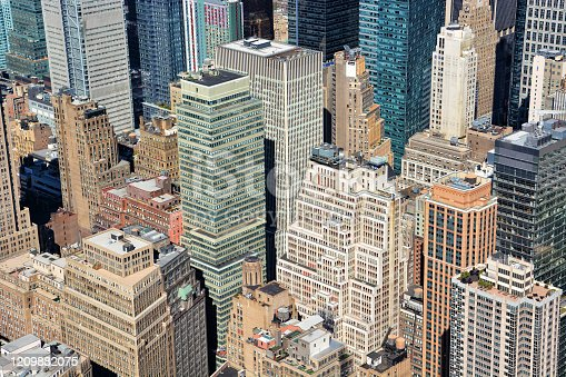 598224046 istock photo Aerial view of skyline with crowded skyscrapers and buildings in Manhattan, New York City, USA 1209882075
