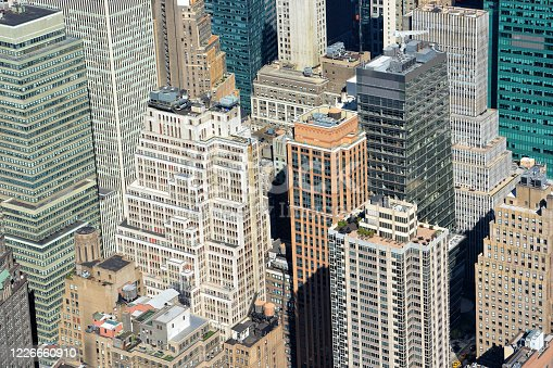 598224046 istock photo Aerial view of skyline with crowded skyscrapers and buildings in Manhattan, New York City, USA 1226660910