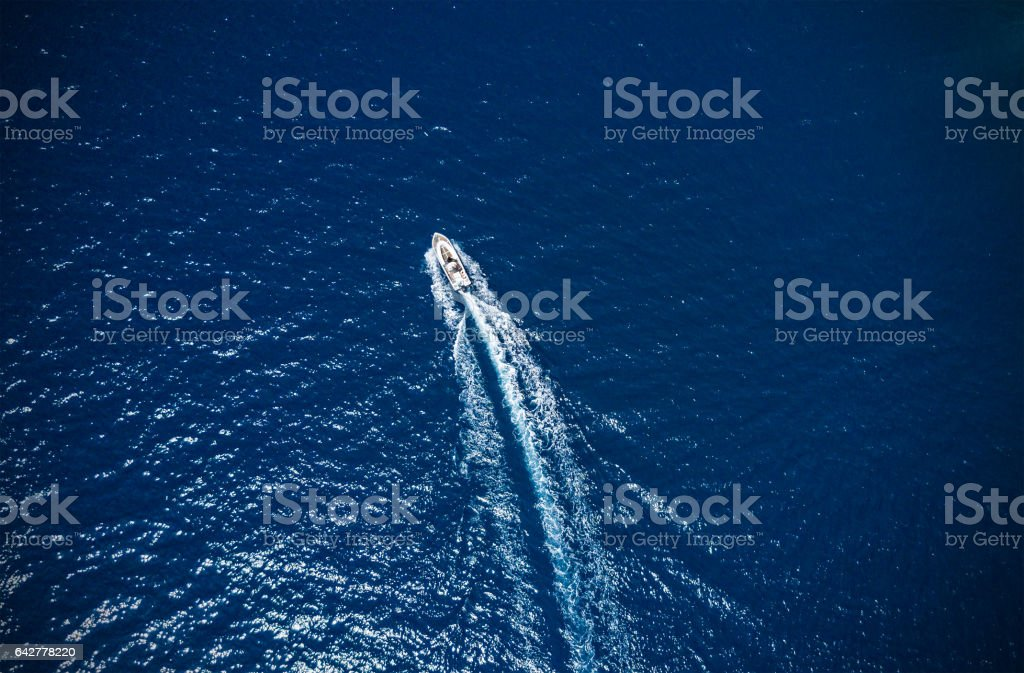 Aerial view of small boat flowing in sea stock photo