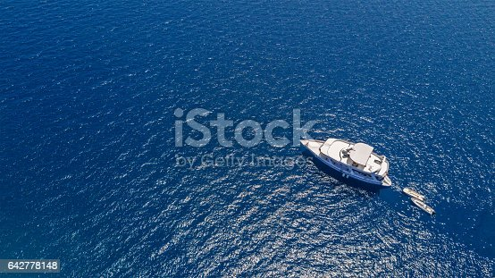 istock Aerial view of small boat in sea 642778148