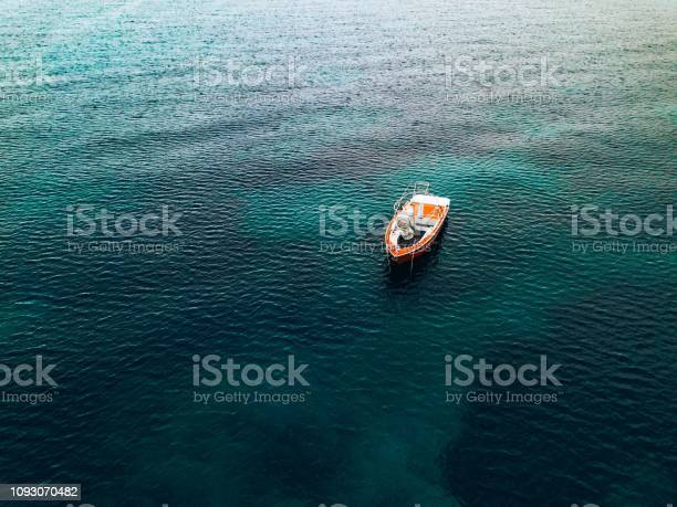 Photo of Aerial view of small fishing boat at sea, Greece.