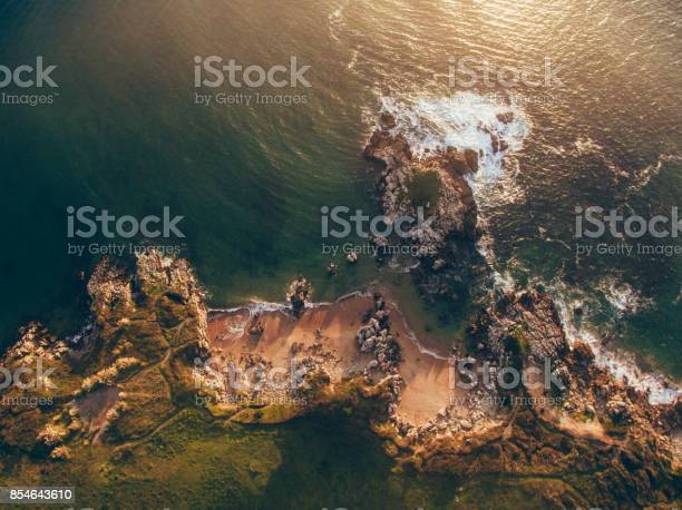 Photo of Aerial view of small rocky beach