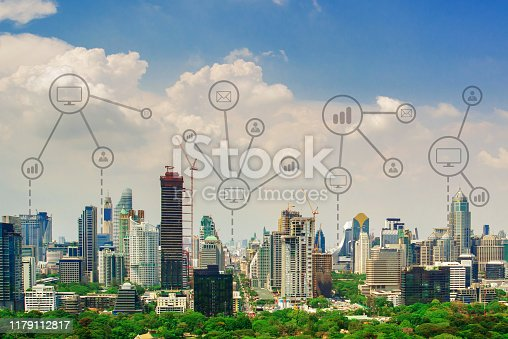 1155541483istockphoto Aerial view of smart city concept at dusk, global network connection in business district with futuristic concept. 1179112817