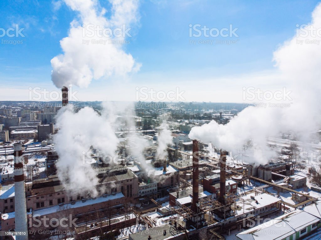 aerial view of smog pollution from city factory. winter time