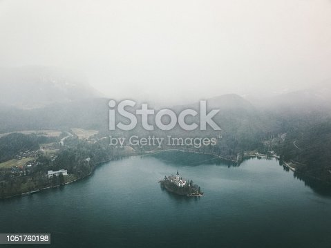 Drone photo of winter lake Bled, Julian Alps and beautiful island