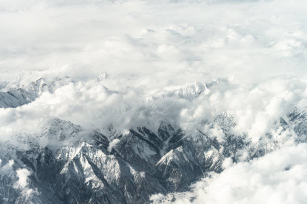 Aerial View of Snow capped Mountains against Sky stock photo