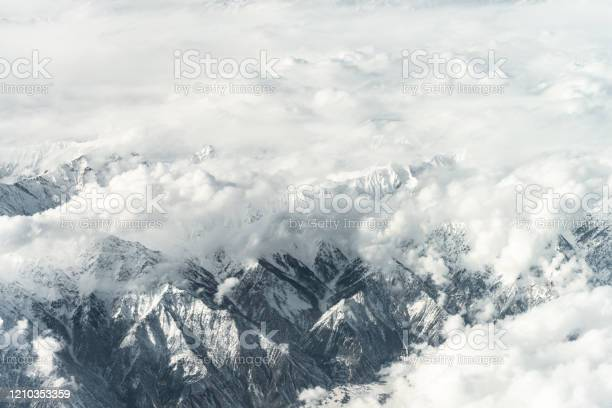 Photo of Aerial View of Snow capped Mountains against Sky