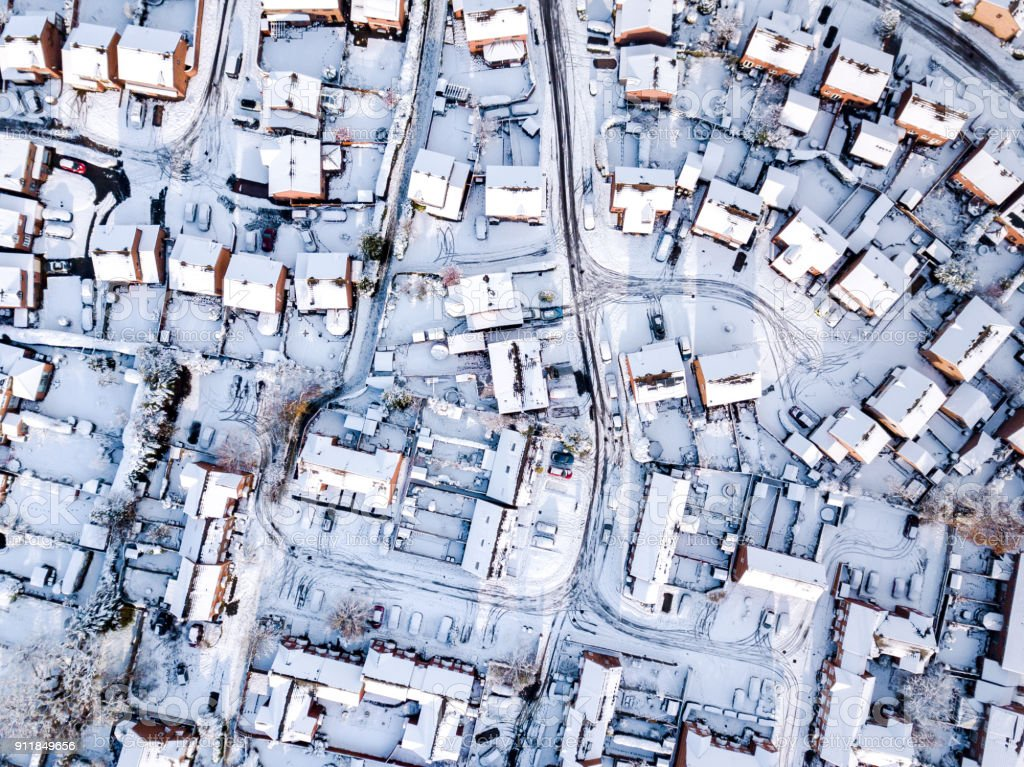 Aerial view of snow covered traditional housing suburbs in England. stock photo