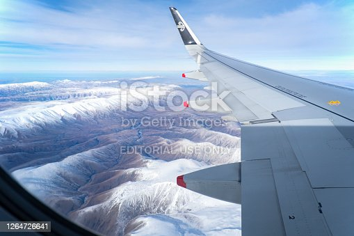 istock Aerial view of snow-capped mountain ranges in winter from the window of an Air New Zealand flight while flying towards Queenstown on July 24 2020 1264726641