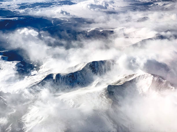 Aerial view of snowcapped Rocky Mountains near Denver, Colorado stock photo