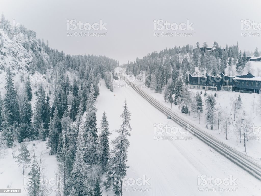 Aerial view of snow-covered road adn wood in the countryside Finland stock photo