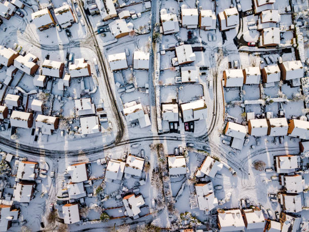 Aerial view of snowed in traditional housing suburbs in England. stock photo