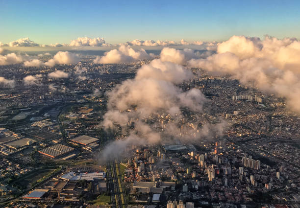 Aerial view of São Paulo amid some clouds in a clear sky evening São Paulo at evening in a clear sky summer day amid some clouds. Aerial photography. amid stock pictures, royalty-free photos & images