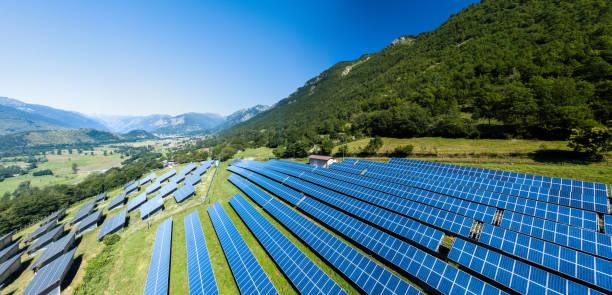 aerial view of solar power station - pannelli solari foto e immagini stock