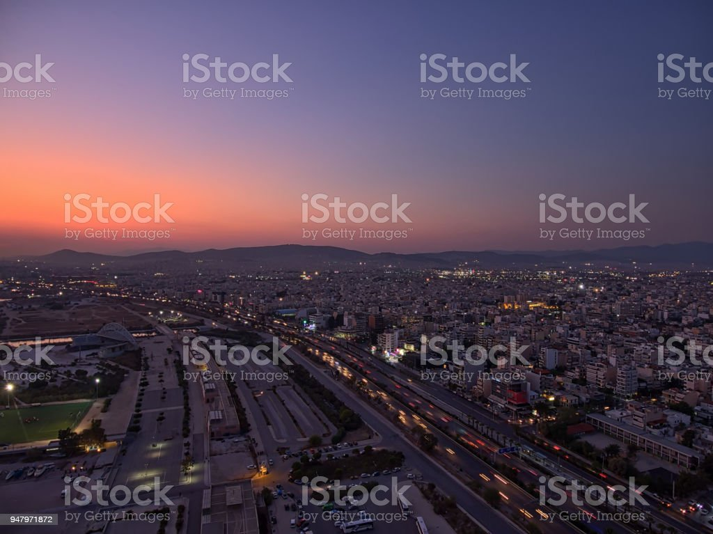 Aerial view of south Athens and the suburbs of Kalithea, Moschato, Tzitzifies and the faliro coastal zone at dusk. stock photo