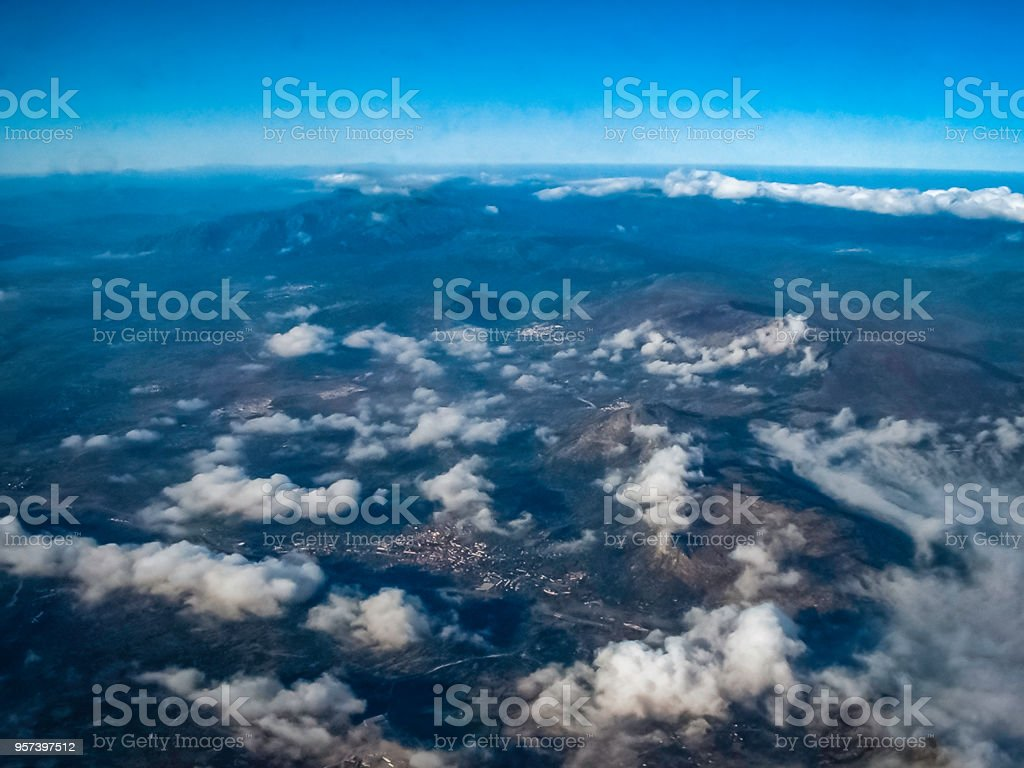 Aerial View of Spanish Mountain Villages with a cloudy blue sky and distant horizon stock photo