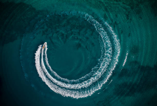 Aerial view of speedboat creating wheel shape stock photo