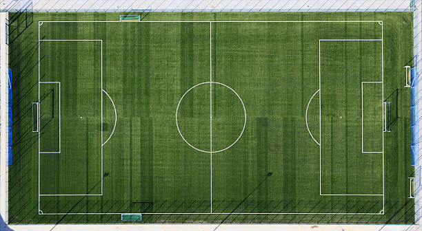 aerial view of sports field with white markings - soccer field stock photos and pictures