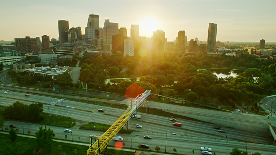 Aerial shot of Minneapolis, Minnesota at sunrise, looking across Interstate 394 and Loring Park towards the Downtown Skyline.