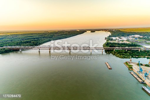 Aerial view of a steel truss bridge over the Danube River - (Bulgarian: Дунав мост, Русе, България).  River connecting Bulgarian and Romanian banks between Ruse and Giurgiu cities.  The picture is taken with DJI Phantom 4 Pro drone / quadcopter