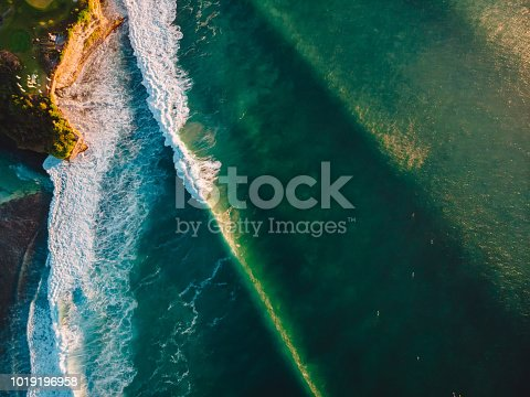 843079528istockphoto Aerial view of stormy waves at sunset. Biggest ocean wave with green tones 1019196958