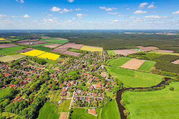 Aerial view of suburban area and agricultural land in Germany Aerial view of a suburban area and agricultural land in Germany.Small village is suburb from Celle, in Lower Saxony, Germany. lower saxony stock pictures, royalty-free photos & images