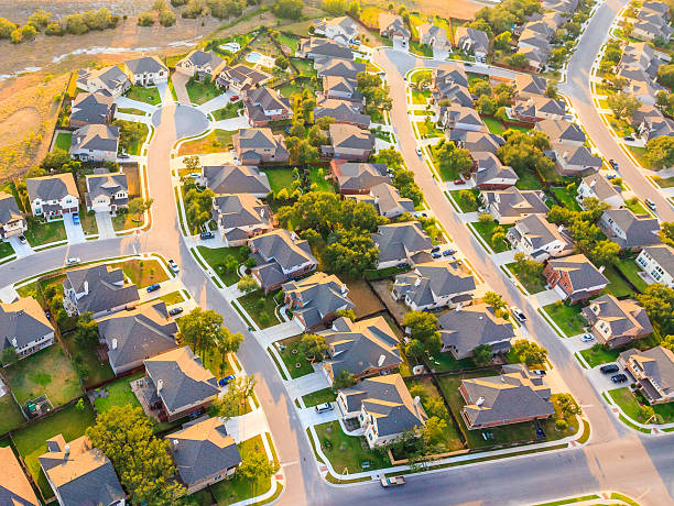 aerial view of suburban Austin Texas Aerial view of suburban housing near Austin Texas with bike path and green belt. urban sprawl stock pictures, royalty-free photos & images