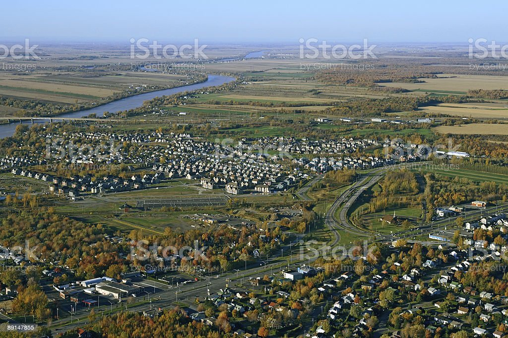 Aerial view of suburban neighborhood near highway royalty-free stock photo