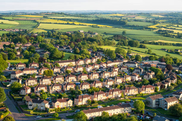 aerial view of suburban streets and fields - council flat stock photos and pictures