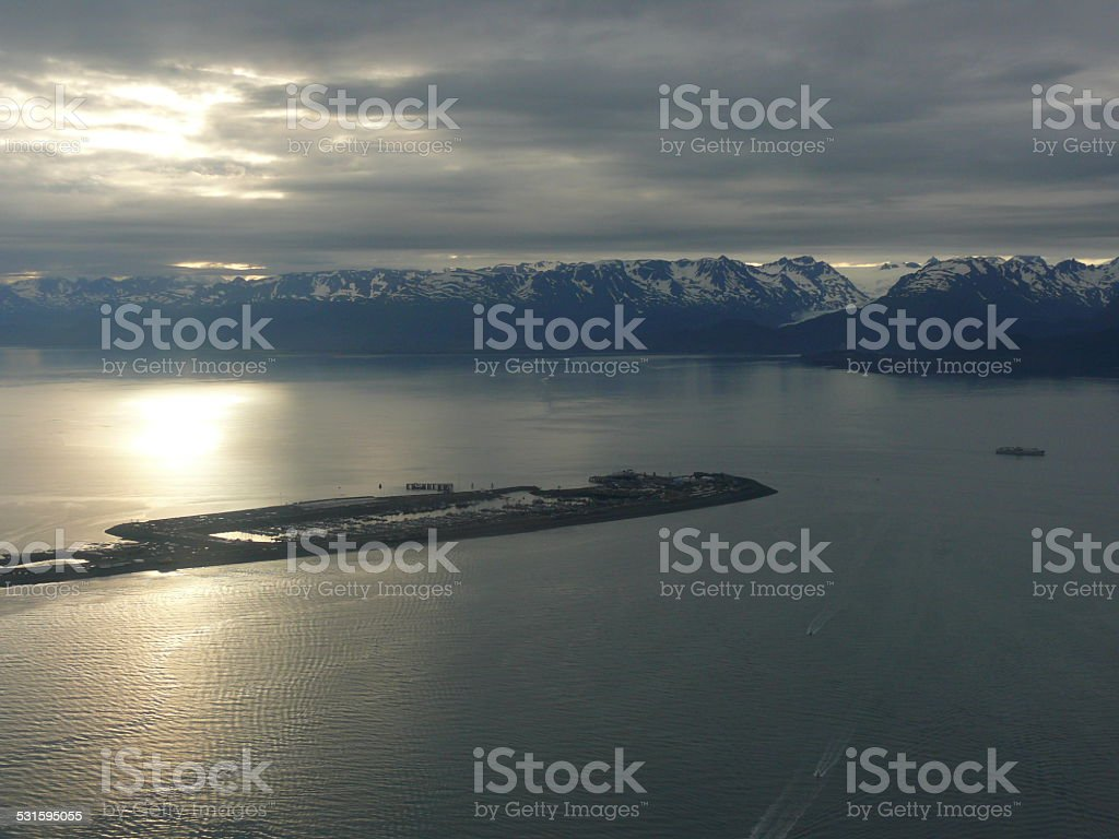 Aerial view of sun setting on Homer Spit, Alaska stock photo
