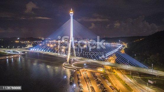 aerial view of Sungai Kebun Bridge with the water village at Bandar Seri Begawan, Brunei Darussalam. night shot