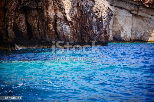 811600544istockphoto Aerial view of sunny beach and transparent clean sea water 1137405231