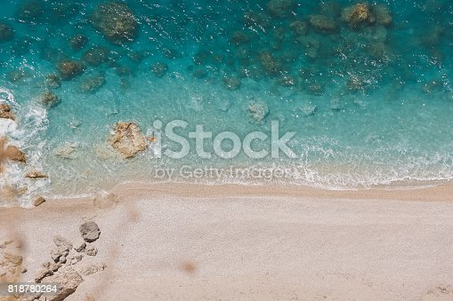 811600544 istock photo Aerial view of  sunny beach and transparent clean sea water 818780264