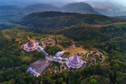 Aerial view (drone shot) of sunrise scence of two pagoda on the top of Inthanon mountain in doi Inthanon national park, Chiang Mai, Thailand