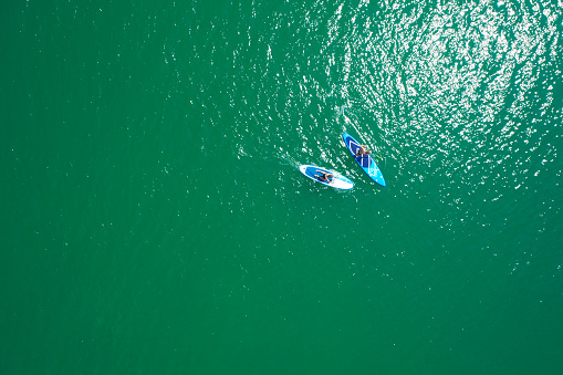 Aerial view of sup boards on the sea. Top view of two paddleboard on a sunny day. View from above.