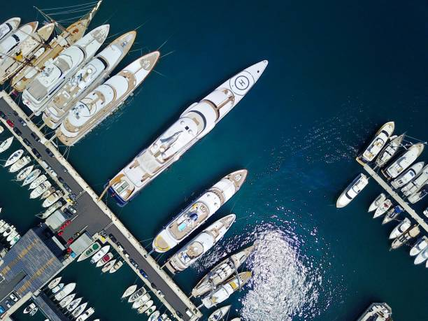 Aerial view of super yachts in harbor on the Mediterranean coast Yachts line the Harbour in Monaco - Monte Carlo mooring stock pictures, royalty-free photos & images