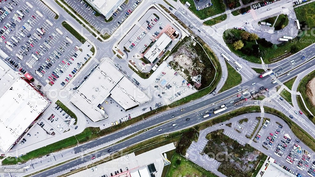 Aerial view of supermarkets, car parks and roads. stock photo
