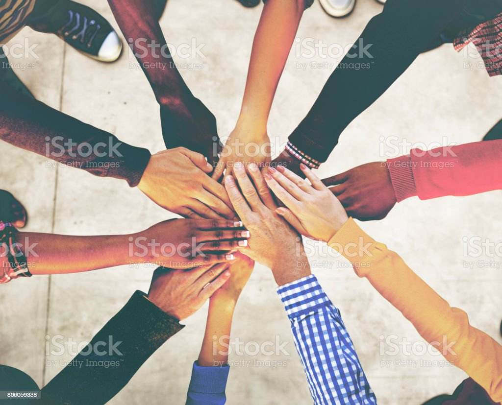 Aerial view of supported hands out together stock photo