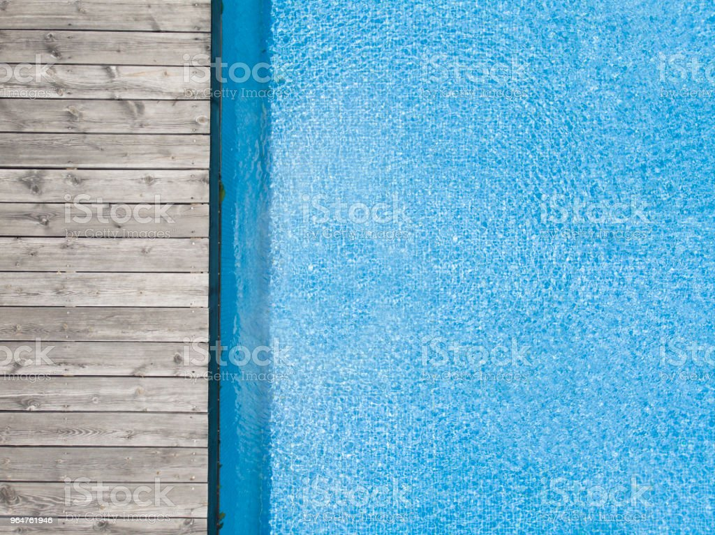aerial view of swimming pool with wooden plank board royalty-free stock photo