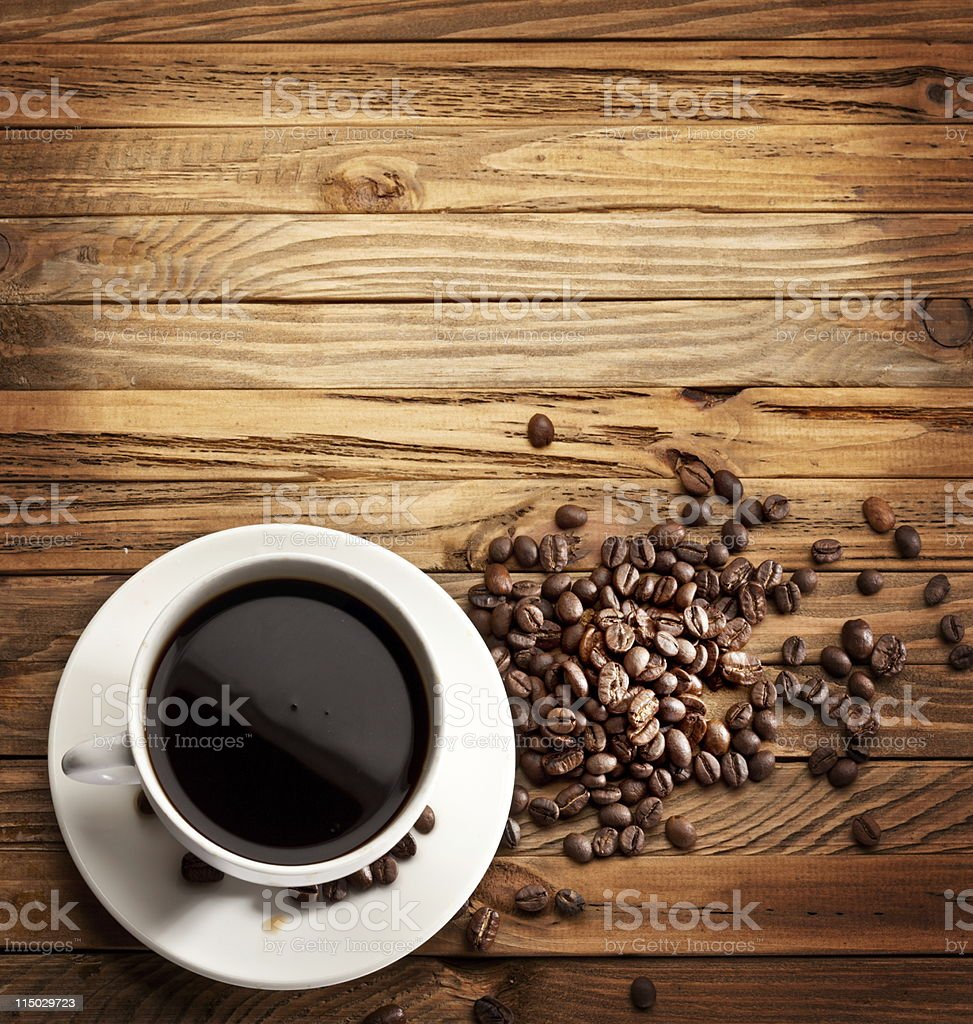Aerial view of table with coffee cup and beans stock photo
