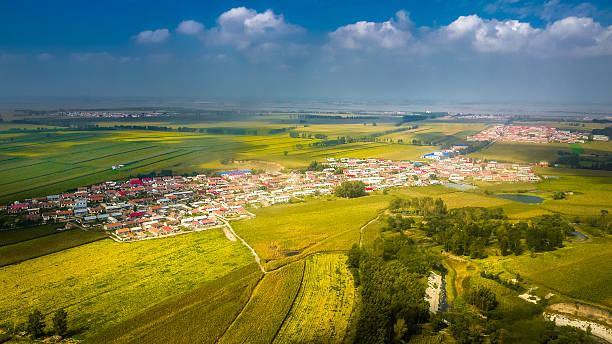 Aerial view of Tai'an village of Harin on Songnen Plain Tai'an village and fields next to Yunliang River on Songnen Plain, Harbin city harbin stock pictures, royalty-free photos & images