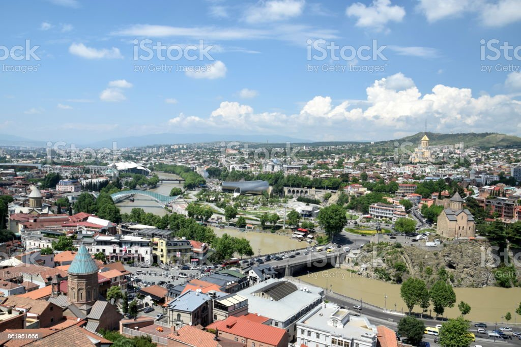 Aerial view of Tbilisi: Tsminda church, Presidential Palace, Rhike Park, Peace Bridge, Metheki church, Sioni Cathedral of the Dormition, and Saint George Cathedral stock photo