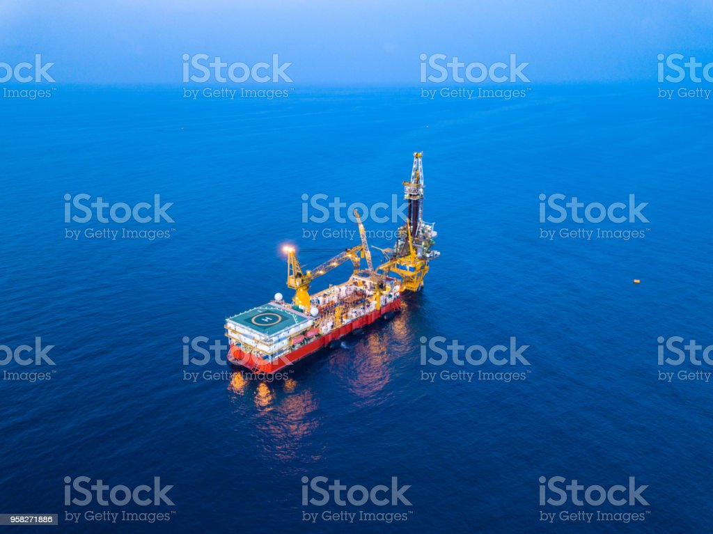 Aerial View of Tender Drilling Oil Rig in The Middle of The Ocean at...