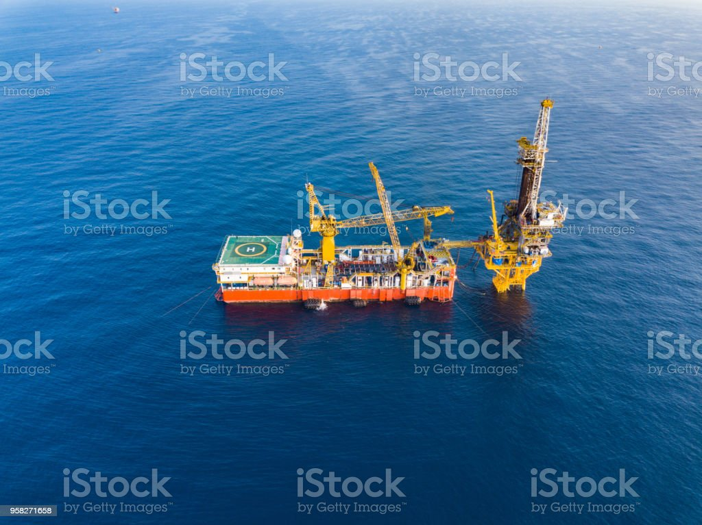 Aerial View of Tender Drilling Oil Rig in The Middle of The Ocean