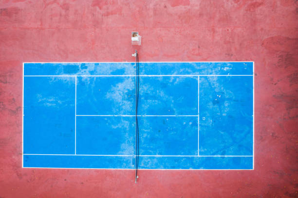 Aerial view of tennis court empty in countryside stock photo