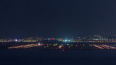 Aerial view of the airport of Nice in South France timelapse. Planes landing and taking off with bright lights