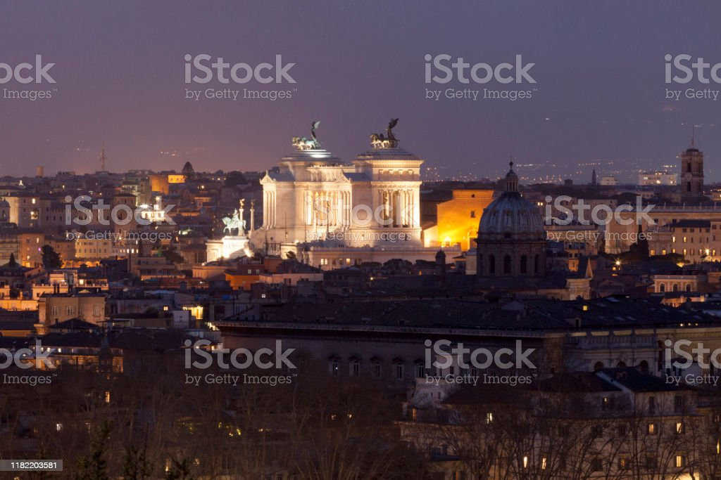 Aerial view of the Altare della Patria in Rome by night The Altare della Patria is a monument built in honor of Victor Emmanuel, the first king of a unified Italy. It occupies a site between the Piazza Venezia and the Capitoline Hill. Aerial View Stock Photo