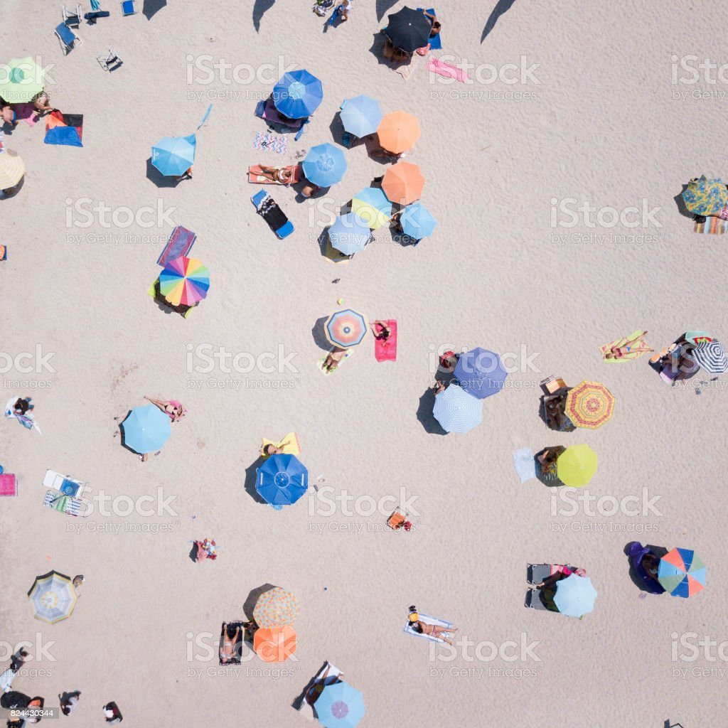 SARDINIA, ITALY, 10 JULY 2017, Aerial view of the amazing beach with colorful umbrella and people who swim. 10 JULY 2017, Sardinia is the second largest island in the Mediterranean Sea stock photo