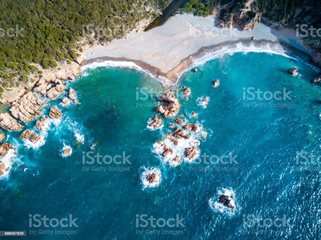 Aerial view of the amazing turquoise beach. 'nEmerald Coast in Sardinia Island, is one of the most beautiful and famous coasts in the world stock photo