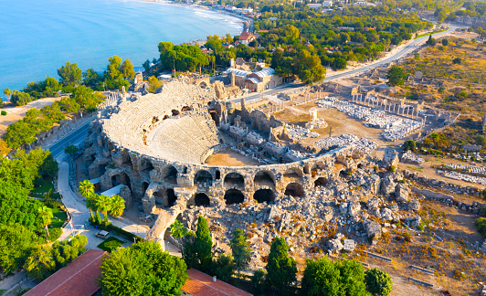 Aerial view of the amphitheater in the ancient Side town, Antalya Province, Turkey. High quality photo